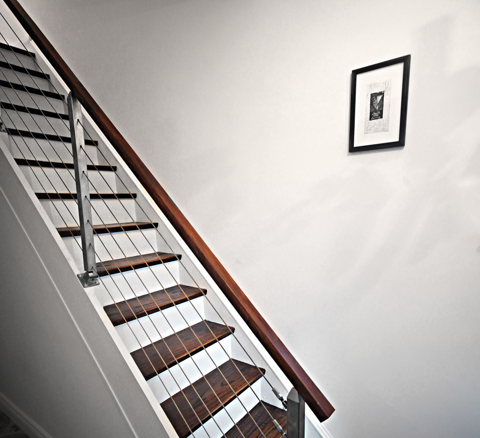 modern railing on closed box stairs